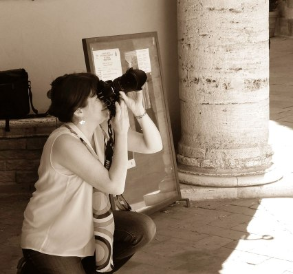 Ann Fisher taking photographs in Pienza Italy