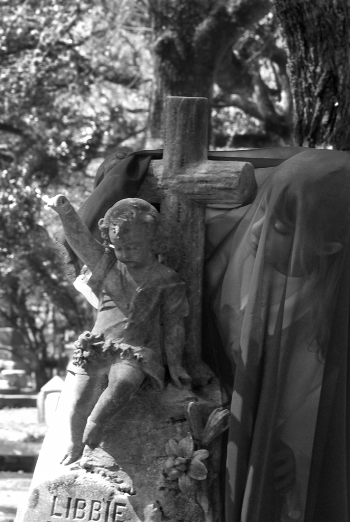 Girl covered in a black veil, Glenwood cemetery