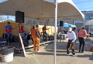 People dancing to live music at the Freret Street Market.