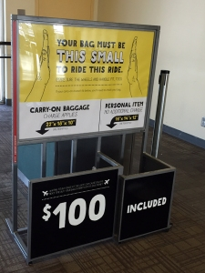 Spirit airlines sign $100 carry on bag policy