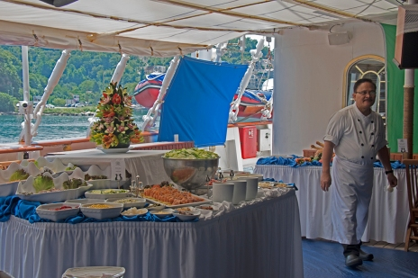 Chef Rudy oversees preparation of the deck lunch buffet.