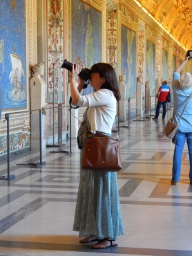 Ann Cavitt Fisher taking photographs in the Vatican Map Room.