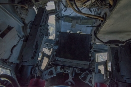 A look down into the ball turret seat.