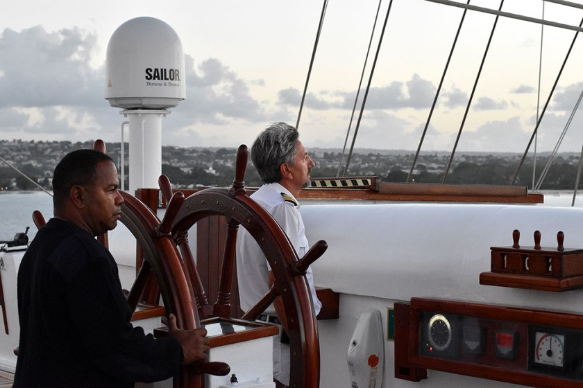 Captain Mariusz Szalek and mate Marco work to bring the Royal Clipper back into Barbados. Photograph, Ann Fisher.