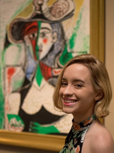 Girl standing in front of a Picasso