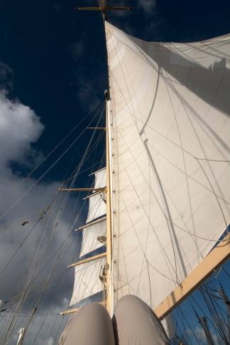 Lounging on deck, looking up at the sails and the sky. Photograph, Ann Fisher.