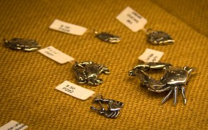 Tiny sterling silver crabs in a variety of designs.