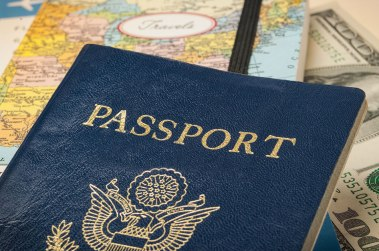 Photograph of US passport on a map.
