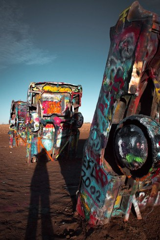 Cadillac Ranch at sunrise, with photographer's shadow