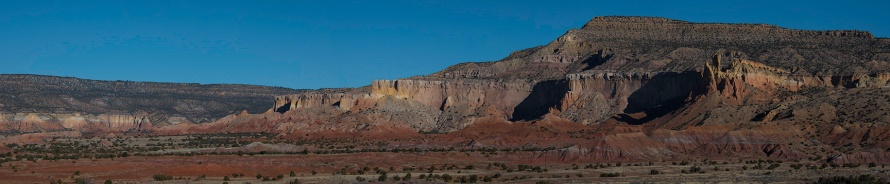 Panoramic view, looking towards the red rock formations at Ghost Ranch.