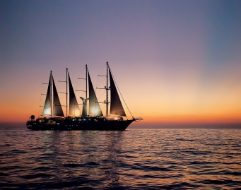 Windstar's Wind Surf yacht at sunset. Photograph courtesy of Windstar.