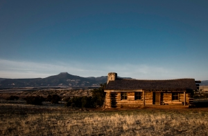 City Slickers Cabin on Ghost Ranch at sunrise, Pedernal mountain in the distance.