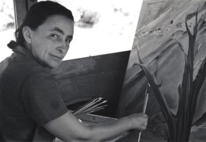 Ansel Adam's photograph of O'Keeffe painting inside her car on Ghost Ranch.