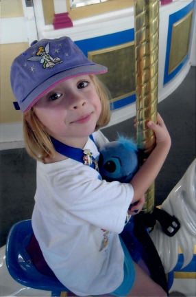 Catherine and Stitch ride Cinderella's Carousel in 2004.