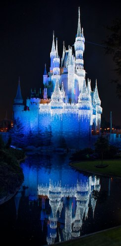 Cinderella's castle in Disney World with Christmas lights.