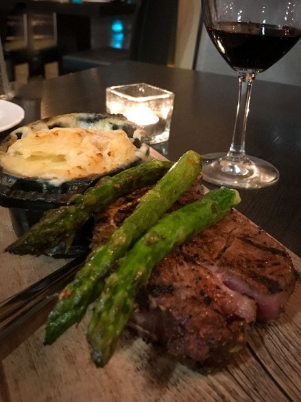 Bone-in tenderloin with roasted asparagus - dinner at the Sonesta Ft. Lauderdale. Photograph, Ann Fisher.
