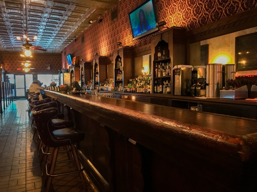 The long, long wooden bar at the Esquire Tavern in San Antonio.
