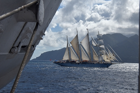 Star Clipper sails with Royal Clipper near Roseau, Dominica.