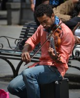 Street musician playing the violin, Jackson Square in New Orleans.