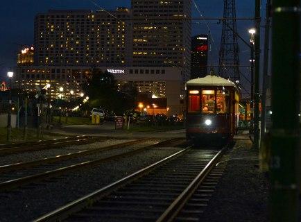 Streetcar along the river at twilight.
