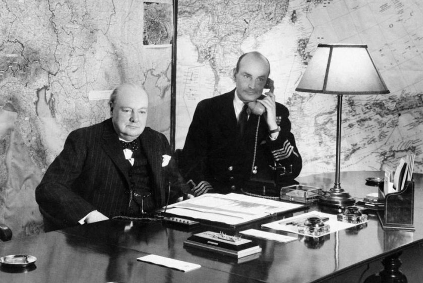 Winston Churchill in the Map Room, July 1945, with and Captain RP Pim next to him.