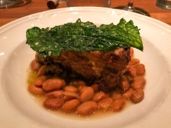 Pork shoulder with potlikker pinto beans at Fixe restaurant in Austin Texas