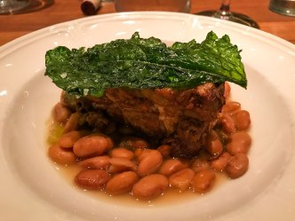 Pork shoulder with potlikker pinto beans at Fixe restaurant in Austin Texas