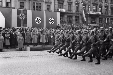 Hitler reviews troops in Prague after annexation of the Sudetenland.