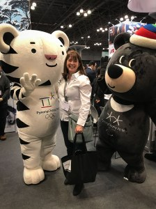 New York Times Travel Show exhibit: Getting a hug from Soohorang, the mascot of the PyeongChang 2018 Olympic Winter Games, is a white tiger -- the guardian animal of South Korea.
