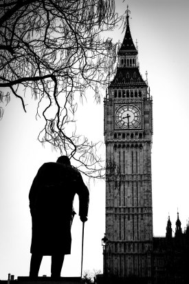 Statue of Winston Churchill facing the Houses of Parliament and Big Ben.