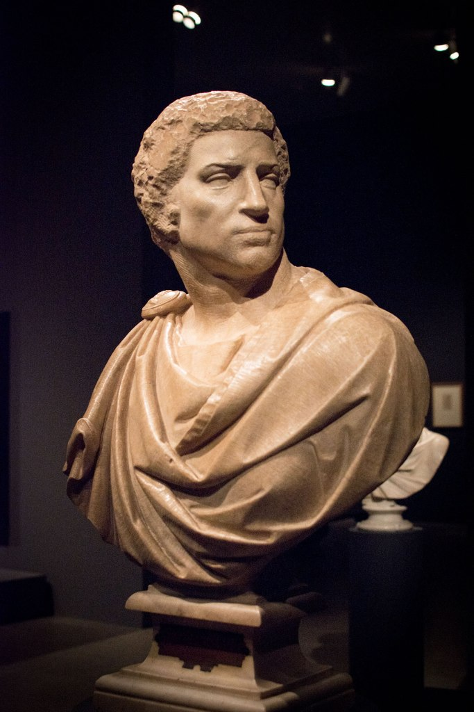 Michelangelo with some assistance from Tiberio Calcagni. Bust of Brutus (unfinished). displayed in the exhibit Michelangelo Divine Draftsman and Designer exhibit at the Metropolitan Museum of Art in New York